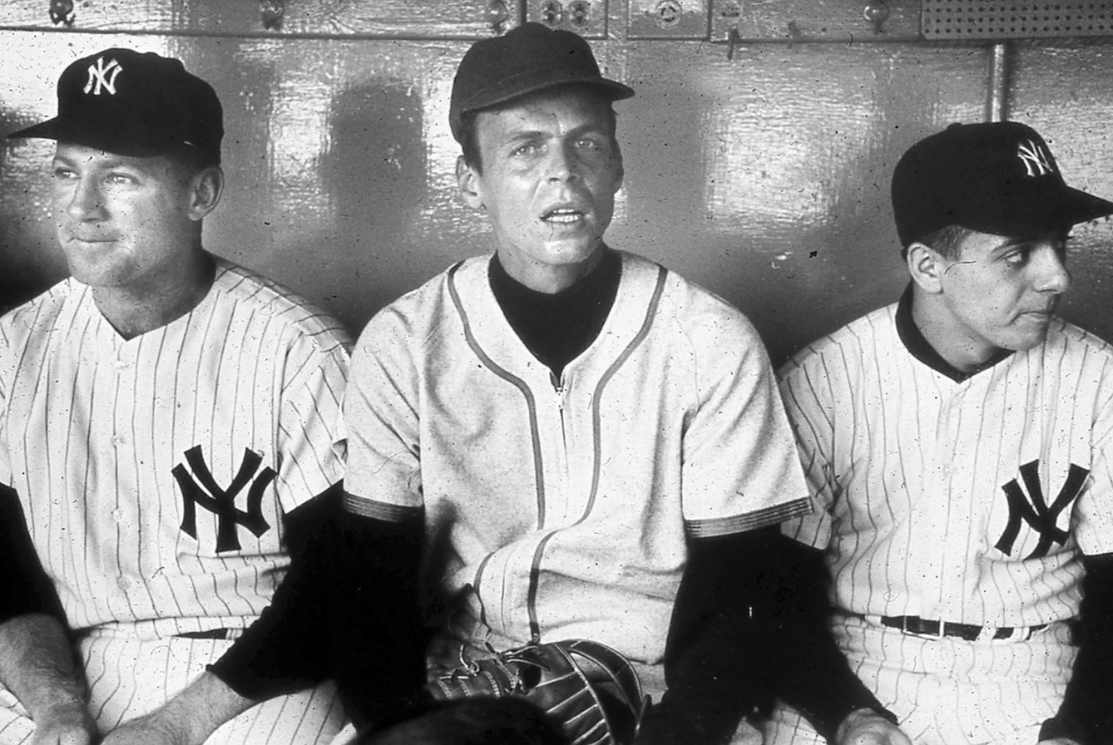 'Flanked by Whitey Ford and the Yankee batboy just after my ordeal,' Plimpton writes in <i>Out of My League</i>. 'The photograph was snapped as I dropped down between them—providing an accurate study of shock, in my case, and justified amusement f